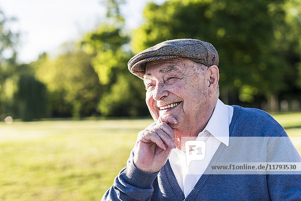 Portrait of smiling senior man wearing cap