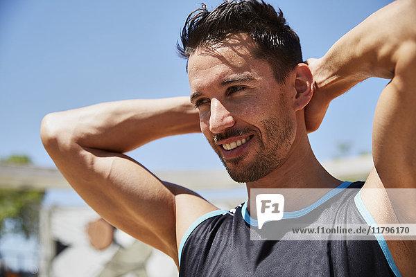 Portrait of confident fit man outdoors