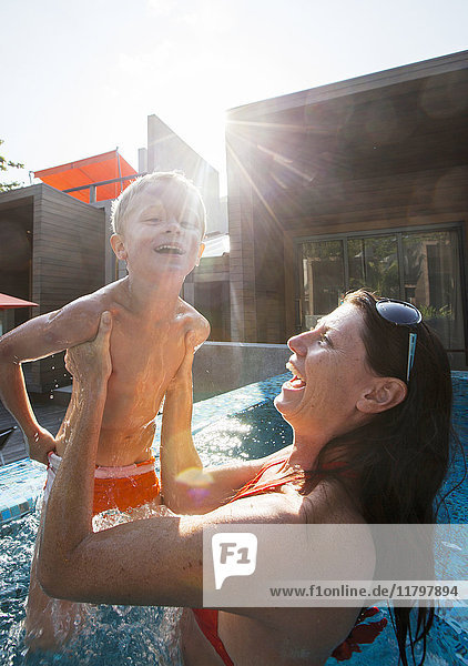 Mother with son in swimming-pool