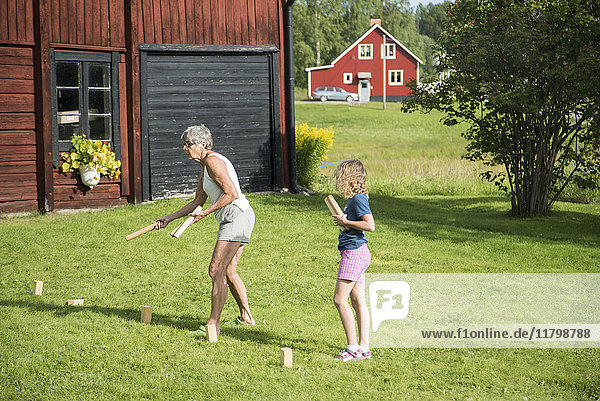 Grandmother and granddaughter playing together