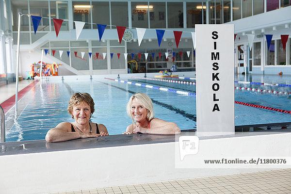 Smiling woman in swimming-pool