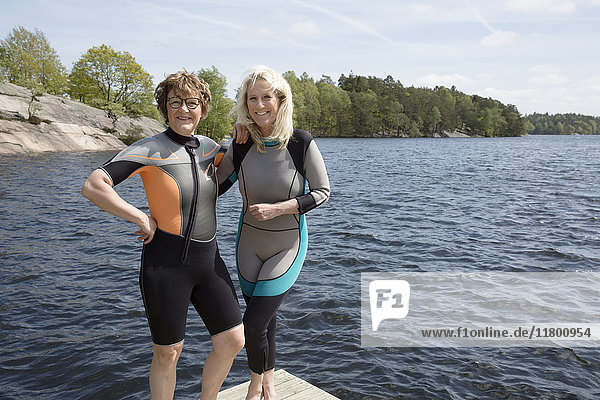 Mother and daughter in wetsuits
