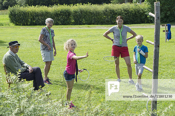 Family playing quoits
