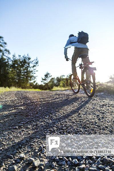 Man on bike in rural area