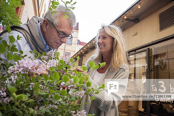 Mature couple shopping at street market