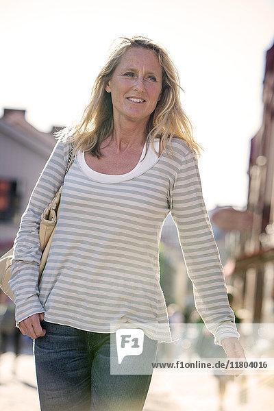 Blond woman walking on street