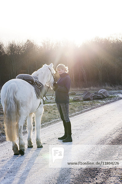 Woman with horse outdoor