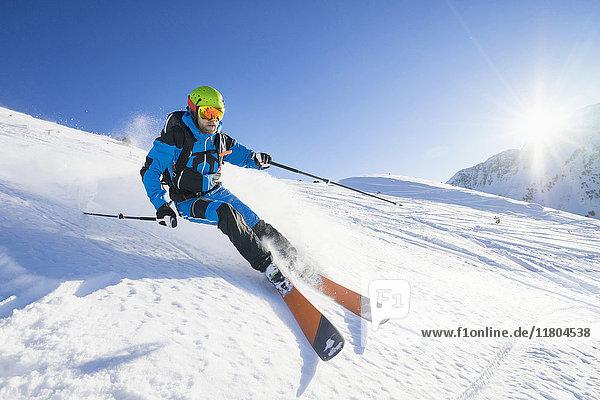 Man skiing on snow against sky