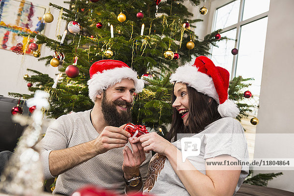 Couple exchanging gift on Christmas