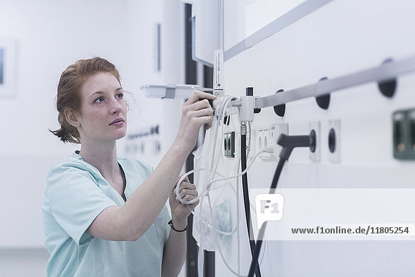 Female nurse adjusting oxygen valve