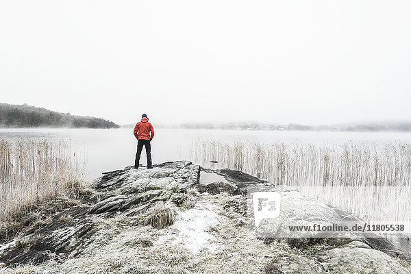 Person at frozen lake
