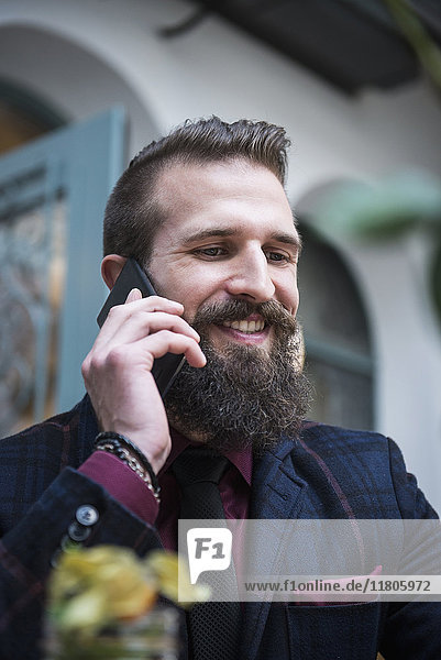 Close-up of young man using mobile phone