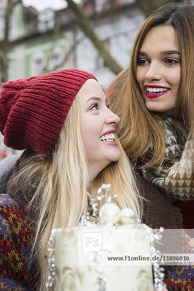 Young women with Christmas gift, Young women with Christmas gift
