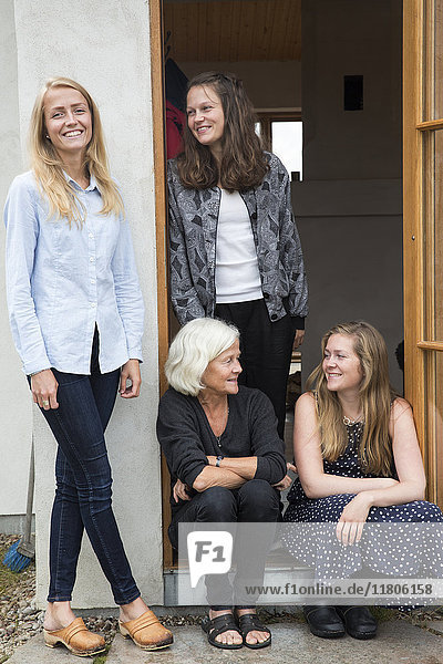 Senior woman with three adult granddaughters