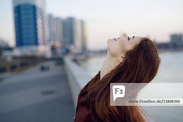 Smiling Caucasian woman at waterfront