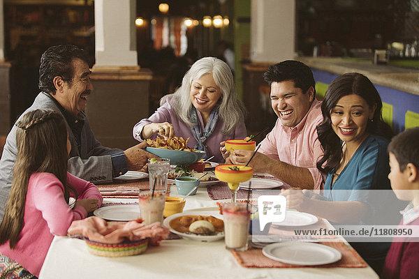 Family enjoying dinner in restaurant