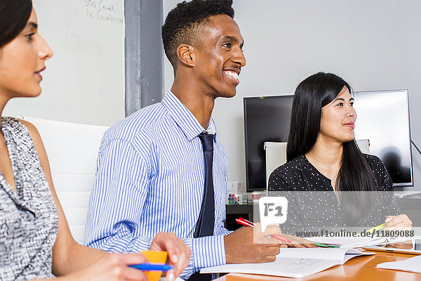 People smiling in business meeting
