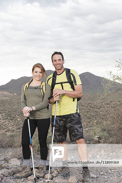 Portrait of smiling couple hiking in desert