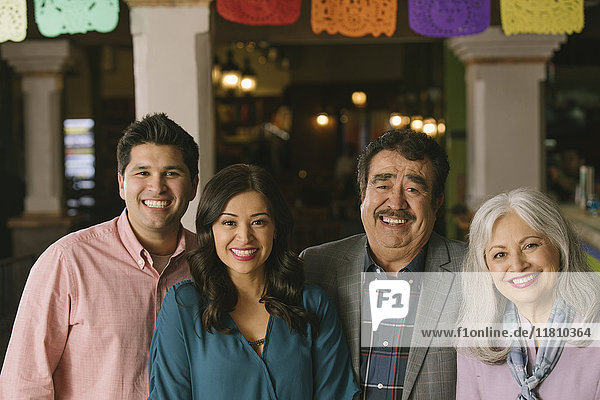 Portrait of smiling couples in restaurant