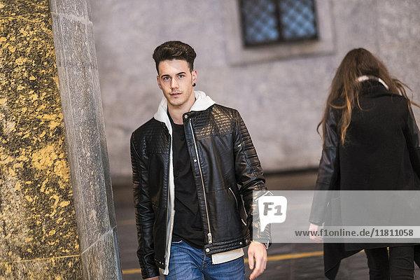 Caucasian man walking in city