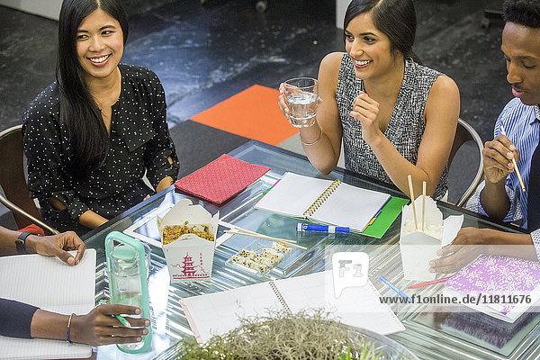 Business people eating food during meeting