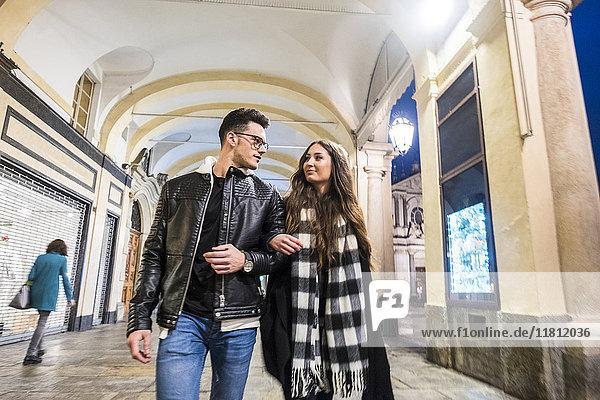 Caucasian couple walking in lobby
