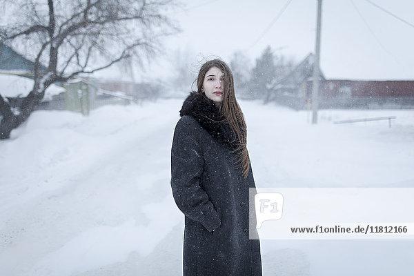 Caucasian woman wearing coat in winter