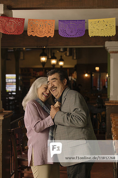 Older couple dancing in restaurant