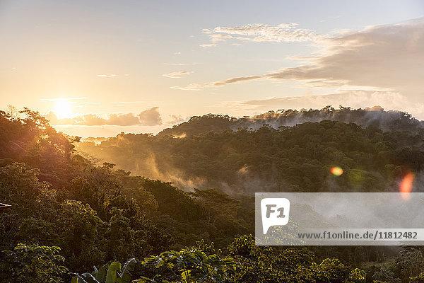 Fog on mountains at sunset
