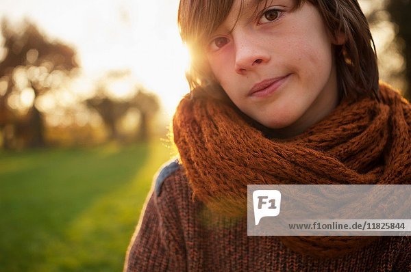 Boy in scarf in countryside  portrait
