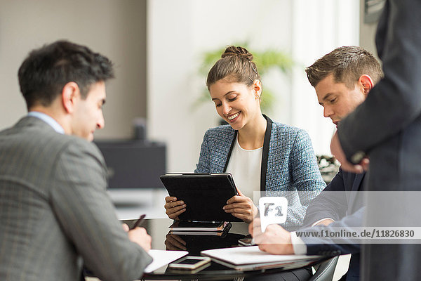 Businessmen and women having office meeting