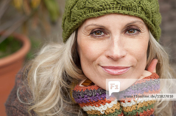 Mature woman in warm clothing and knit hat  portrait