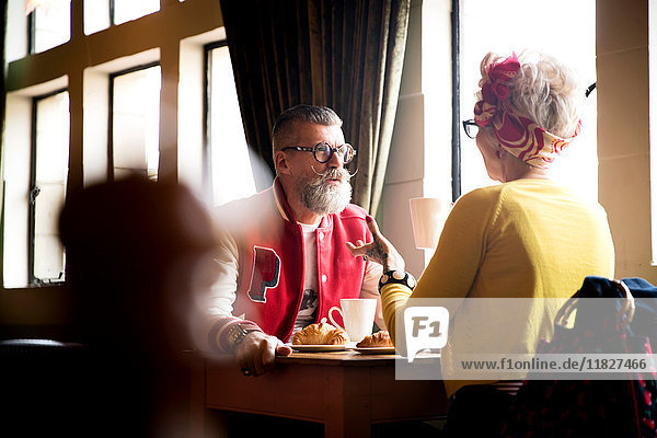 Quirky couple relaxing in bar and restaurant  Bournemouth  England
