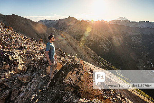 Male mountaineer looking out from top of mountain range  Nahuel Huapi National Park  Rio Negro  Argentina