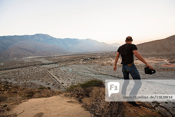 Man on hilltop  Palm Springs  California  USA