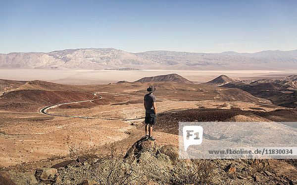 Man on rock looking out over Death Valley National Park  California  USA