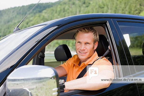 Man in a black car
