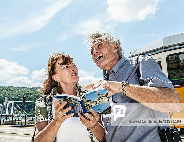 Older couple sightseeing together