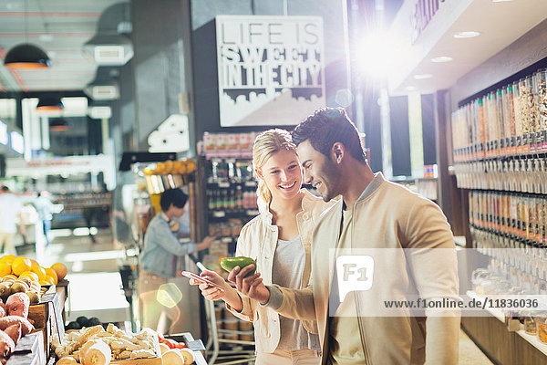 Young couple grocery shopping in market