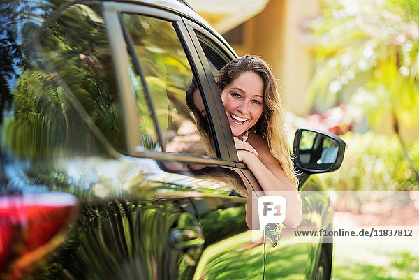 Portrait of woman looking out of car window