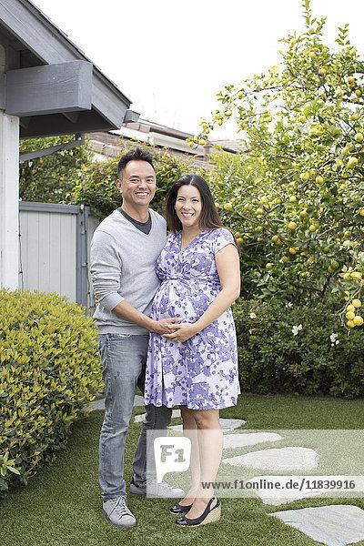 Portrait of smiling pregnant couple