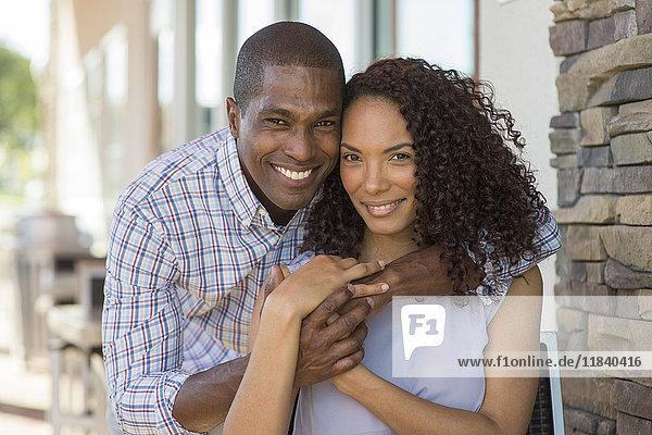 Portrait of smiling couple hugging