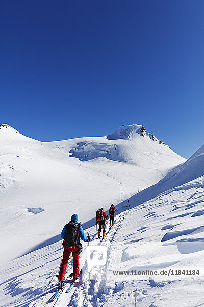 Ski tourers on Monte Rosa  border of Italy and Switzerland  Alps  Europe