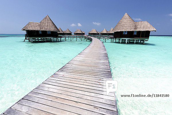 Over-water villas  crystal clear sea and blue sky  Coco Palm  Dhuni Kolhu  Baa Atoll  Republic of Maldives  Indian Ocean  Asia