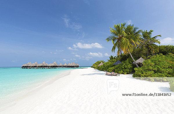 View along tropical beach towards over-water villas  Coco Palm Resort  Dhuni Kolhu  Baa Atoll  Republic of Maldives  Indian Ocean  Asia