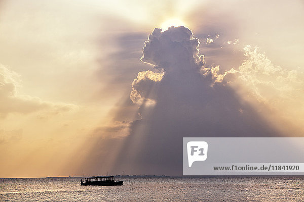 Dramatic cloud formations and boat in silhoutte at sunset  Dhuni Kolhu  Baa Atoll  Republic of Maldives  Indian Ocean  Asia