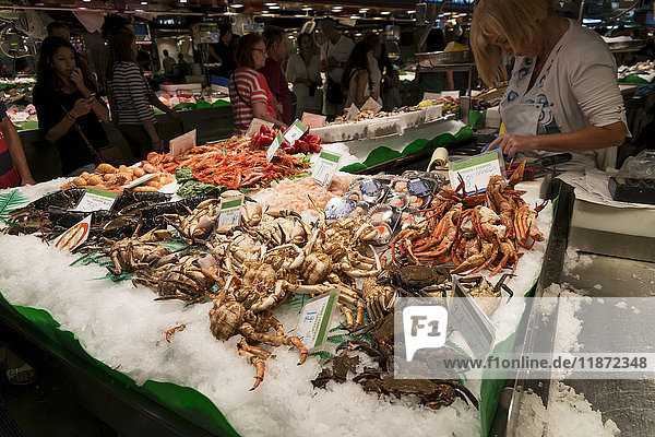 'Fresh seafood sold at Boqueria Market  one of the most famous markets around Spain and the most famous in Barcelona; Barcelona  Catalonia  Spain'