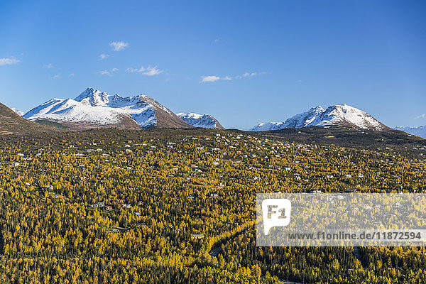 Aerial view of the Hillside neighborhood with Chugach mountains in the background in autumn  Southcentral Alaska  USA