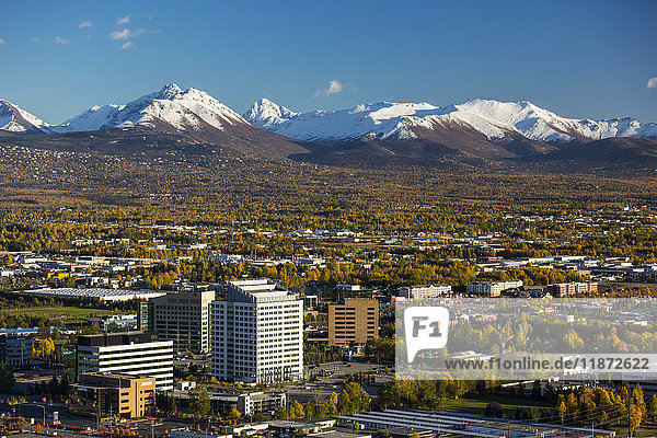 Aerial view of midtown Anchorage and financial buildings with Chugach mountains in the background  Southcentral Alaska  USA