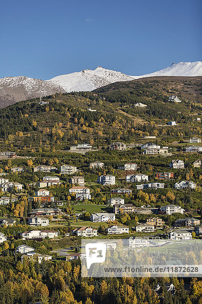 Aerial view of the Hillside neighborhood with the Chugach mountains in the background in autumn  Southcentral Alaska  USA